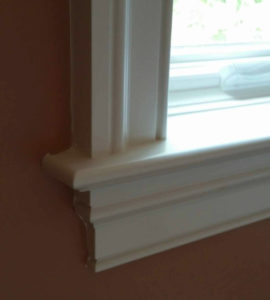 The trim piece below the window sill is called the apron.